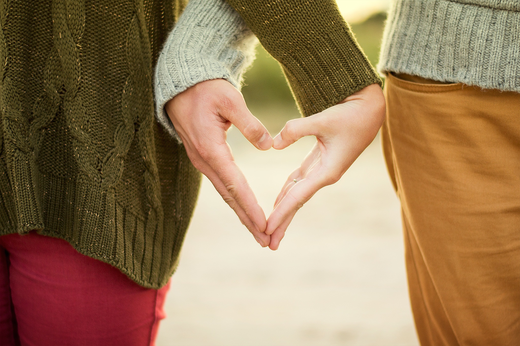Canva - Selective Focus Photography Two Person Making Heart Hand Sign