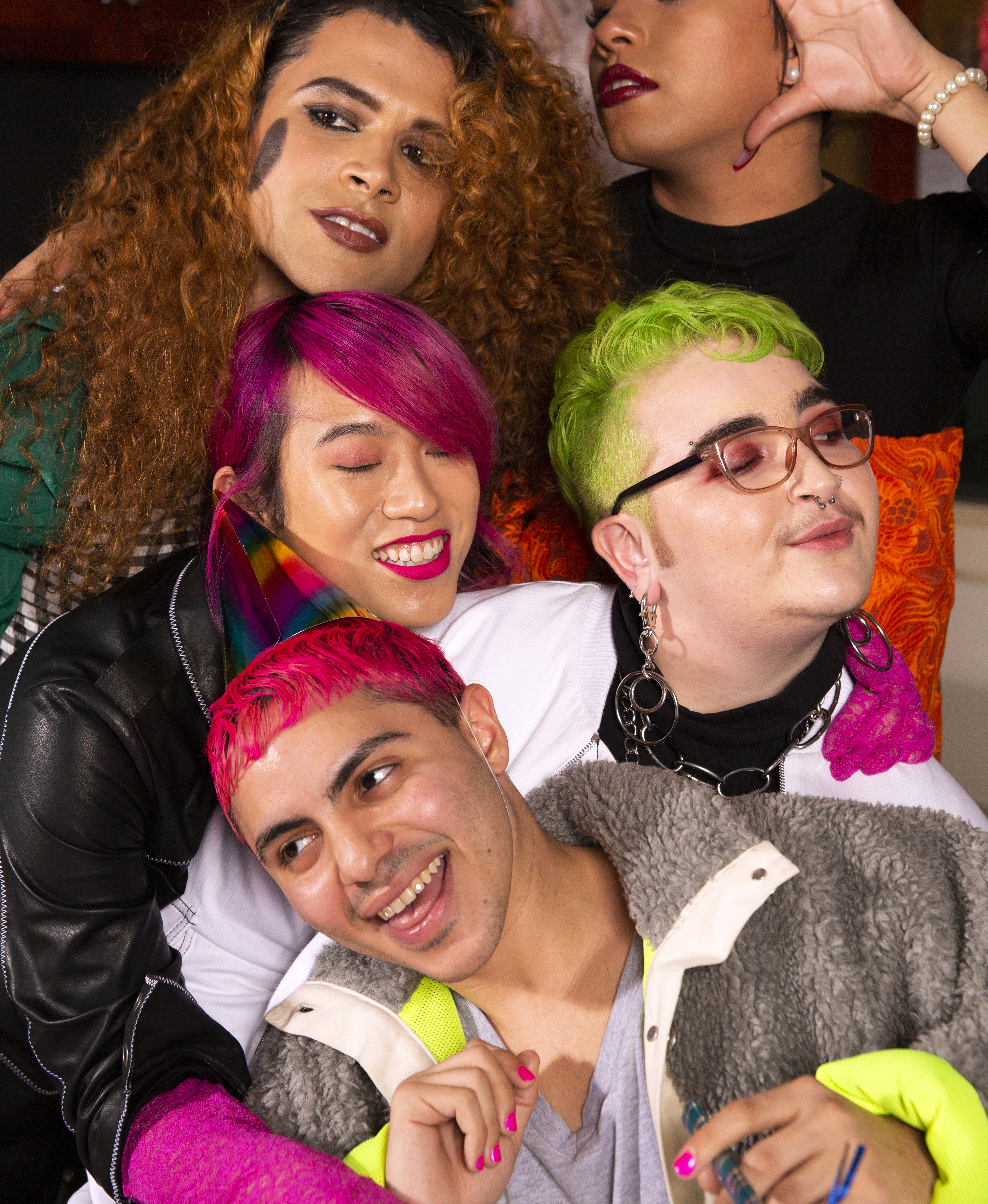 A group of friends of varying genders taking a photo at a party